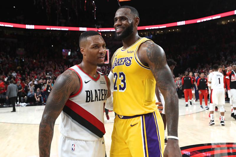 Oct 18, 2018; Portland, OR, USA; Portland Trail Blazers guard Damian Lillard (0) and Los Angeles Lakers forward LeBron James (23) hug after their game at Moda Center. Mandatory Credit: Jaime Valdez-USA TODAY Sports