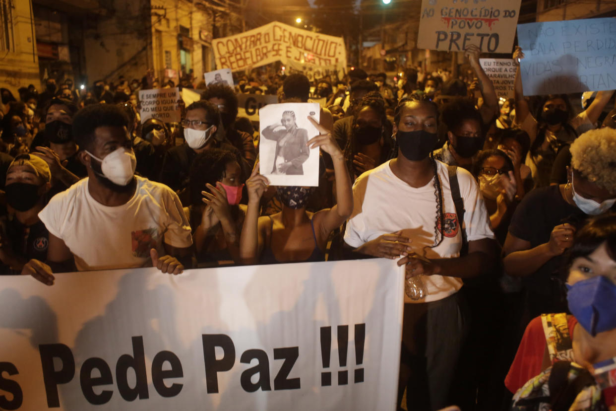 Family and activists protest the day after the killing of Kathlen Romeu, a young pregnant woman killed by a stray bullet, in Rio de Janeiro, Brazil, Wednesday, June 9, 2021. Stray bullets have struck at least six pregnant women in Rio since 2017, but Romeu was the first to die, according to Crossfire, a non-governmental data project that tracks armed violence. (AP Photo/Bruna Prado)