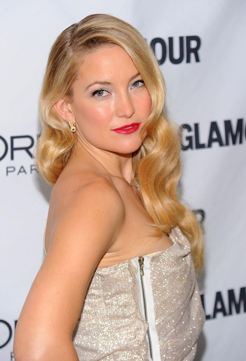 At the Glamour Magazine 2010 Women of the Year Gala, Hudson channels old Hollywood with her sleek S-wave curls with a satin red lip.