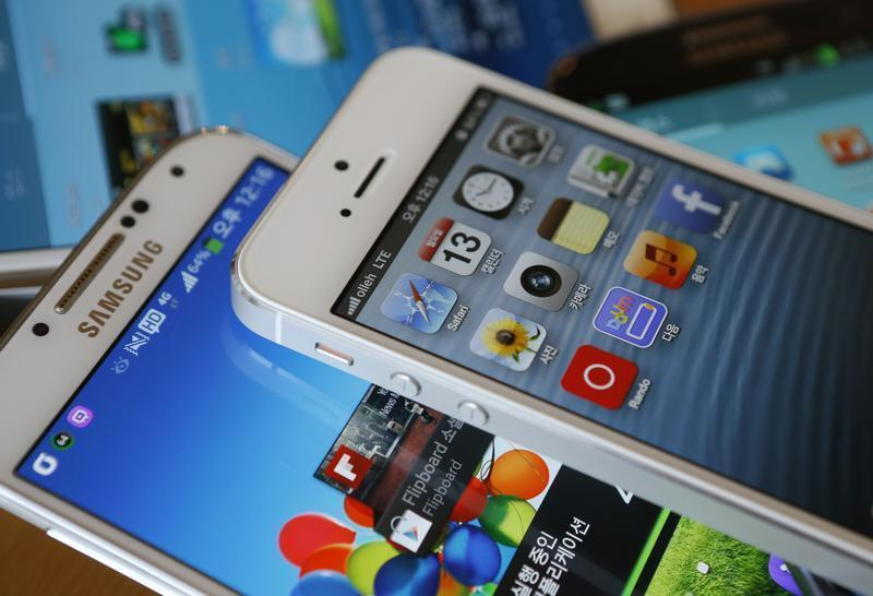 Picture illustration of Apple's iPhone 5 and Samsung Electronics' Galaxy S4 taken in Seoul