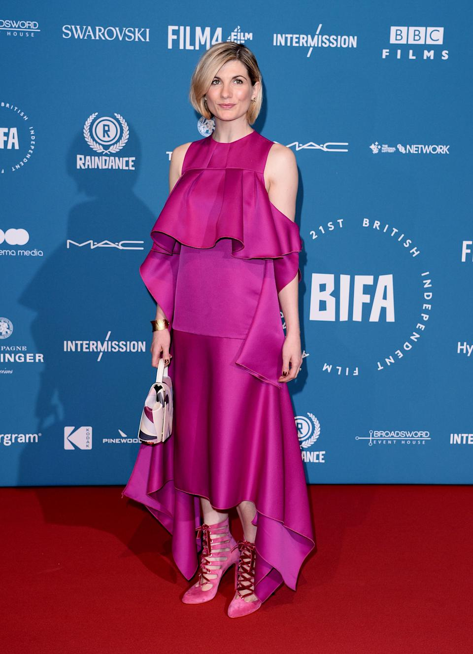 <p>Clad in a custom, fuchsia look by Aphid London, the 'Doctor Who' star showed she's not afraid to be playful with her style. <em>[Photo: Getty]</em> </p>