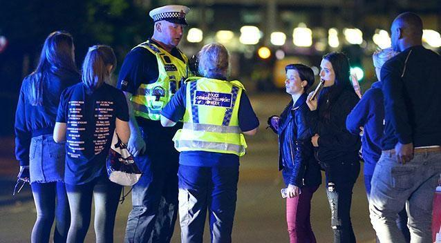Police and fans close to the Manchester Arena. Photo: Getty Images