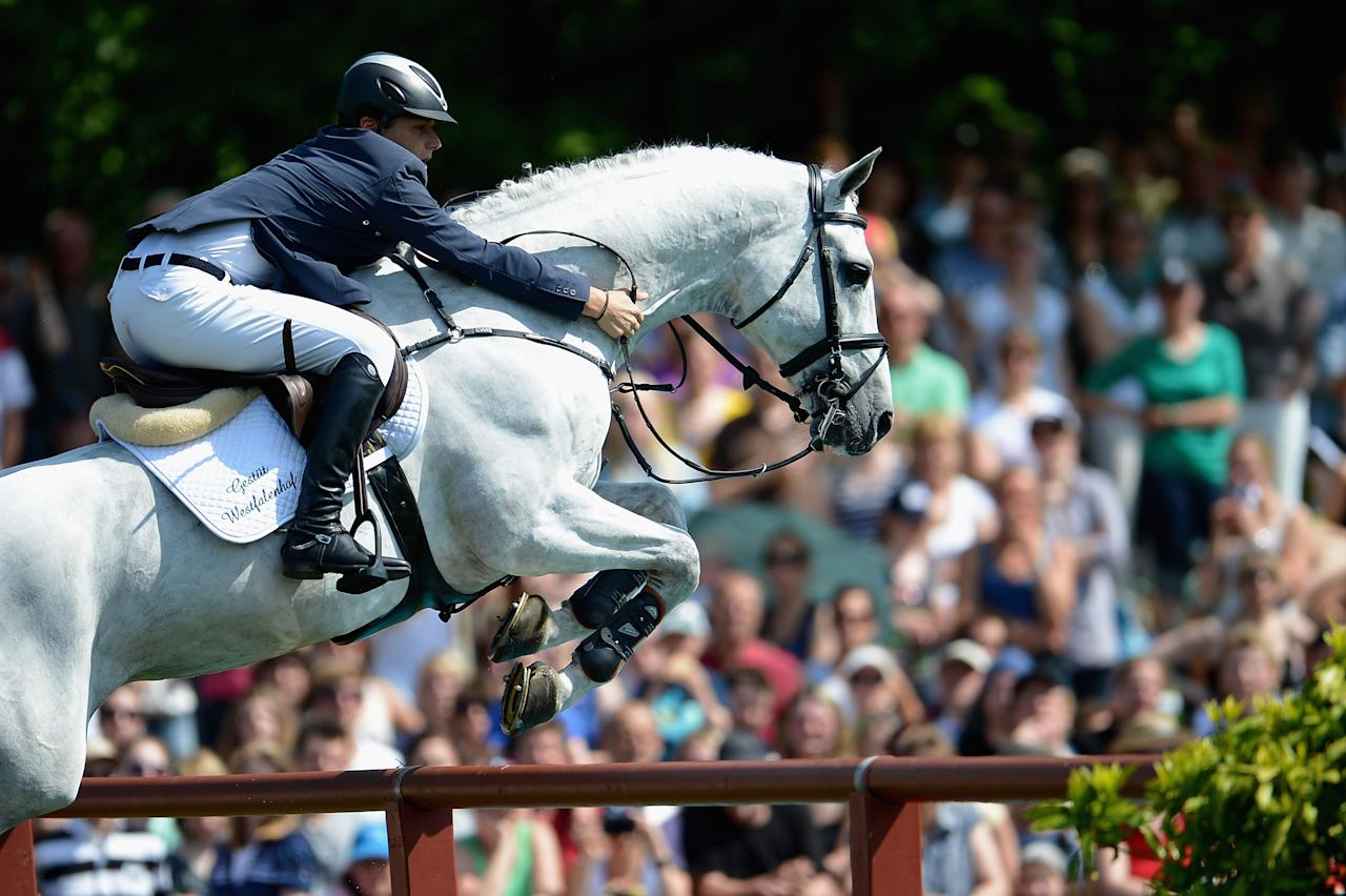 HAMBURG, GERMANY - MAY 20:  Torben Koehlbrandt of Germany and C-Trenton Z compete in the 83rd German Jumping Derby during day four of the German Jumping & Dressage Grand Prix 2012 at Klein Flottbek on May 20, 2012 in Hamburg, Germany.  (Photo by Dennis Grombkowski/Bongarts/Getty Images)