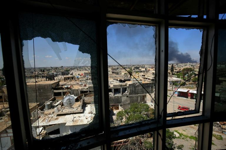 Smoke billows from Mosul's Old City where diehard Islamic State group jihadists are hunkering down as Iraqi forces press an offensive to oust them from the city