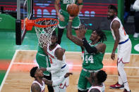 Boston Celtics center Robert Williams III (44) shoots against the New York Knicks during the first half of an NBA basketball game Wednesday, April 7, 2021, in Boston. (AP Photo/Charles Krupa)