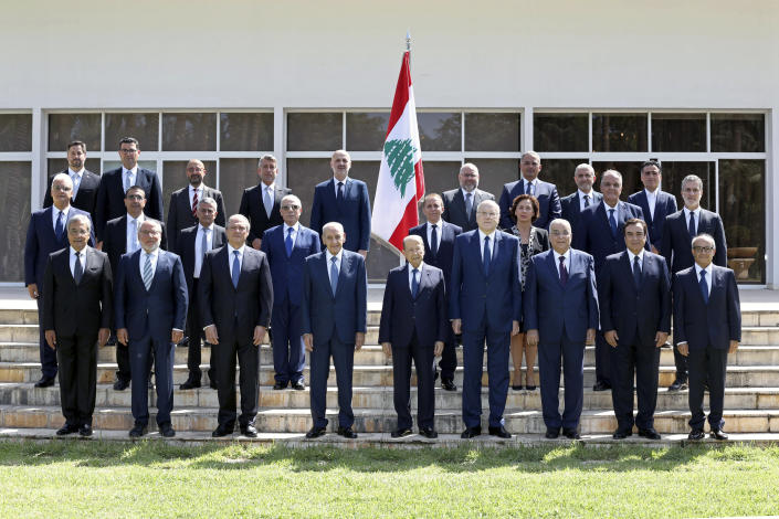 In this photo released by Lebanese government, members of the new government pose for an official picture at the Presidential Palace in Baabda, east of Beirut, Lebanon, Monday, Sept 13, 2021. Front row from left to right are Defense Minister Maurice Slim, Interior Minister Bassam Mawlawi, Deputy Prime Minister Saadeh Shami, Parliament Speaker Nabih Berri, President Michel Aoun, Prime Minister Najib Mikati, Foreign Minister Abdullah Bouhabib, Information Minister George Kordahi, Minister of Youth and Sports George Kallas. (Dalati Nohra/Lebanese Official Government via AP)