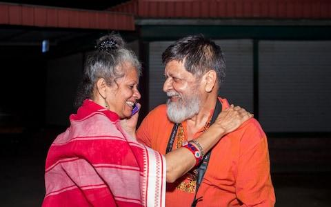 Shahidul Alam celebrates with his wife Rahnuma Ahmad following is release from jail - Credit:  SUMAN PAUL/AFP