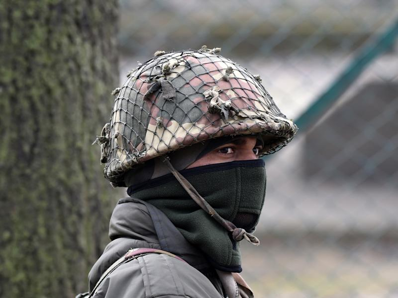 An Indian paramilitary trooper stands guard in Kashmir (file photo): Getty Images