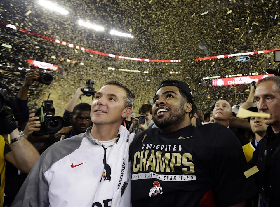 Urban Meyer (L) is shown with former OSU running back Ezekiel Elliott after the Buckeyes' national title win. (AP)