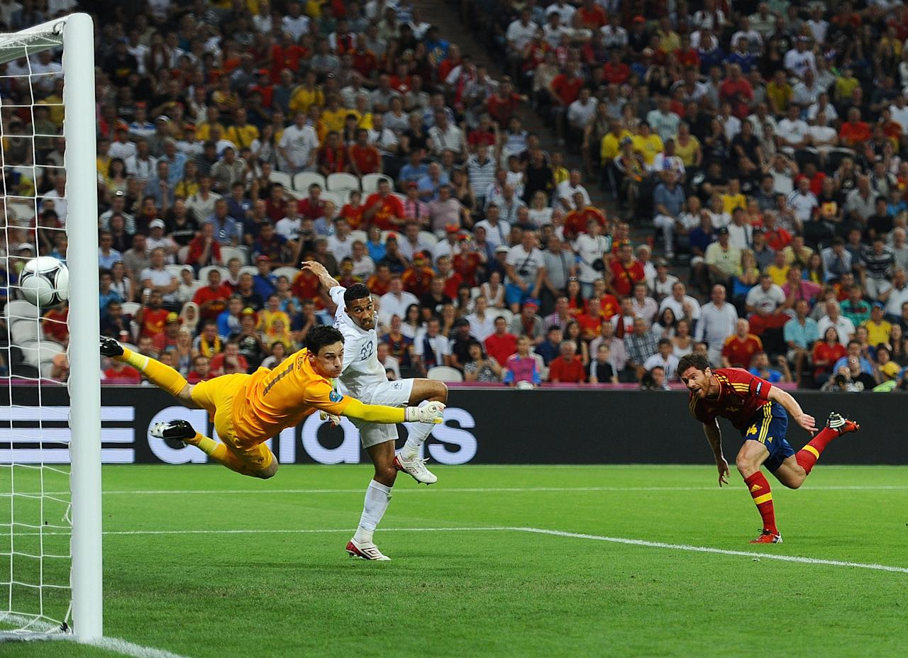 DONETSK, UKRAINE - JUNE 23:  Xabi Alonso of Spain scores the first goal past Hugo Lloris of France during the UEFA EURO 2012 quarter final match between Spain and France at Donbass Arena on June 23, 2012 in Donetsk, Ukraine.  (Photo by Laurence Griffiths/Getty Images)