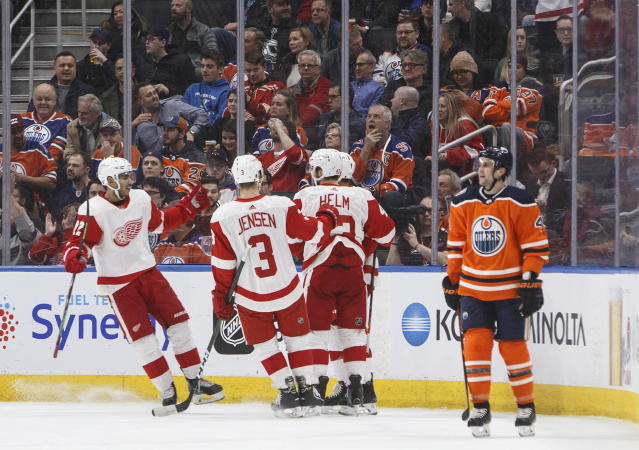 Detroit Red Wings celebrate a goal as Edmonton Oilers' Kris Russell (4) skates past during second period NHL action in Edmonton on Tuesday, Jan. 22, 2019. (Jason Franson/The Canadian Press via AP)