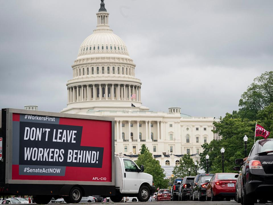 <p>Protesters take part in the AFL-CIO Workers First Caravan for Racial and Economic Justice near the U.S. Capitol on 17 June 2020 in Washington DC</p> ((Getty Images))