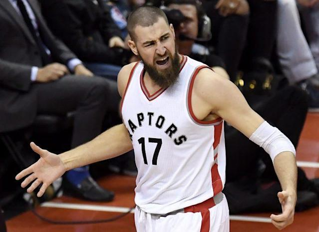 Toronto Raptors center Jonas Valanciunas (17) reacts after getting fouled during first half NBA playoff basketball action against the Milwaukee Bucks, in Toronto on Tuesday, April 18, 2017. THE CANADIAN PRESS/Frank Gunn