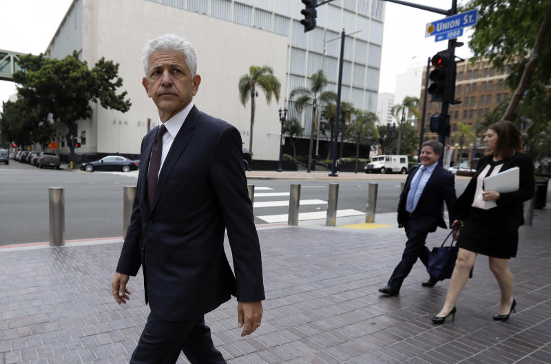 Daniel Petrocelli, lead attorney for President Donald Trump, leaves the courthouse after a hearing Thursday, March 30, 2017, in San Diego. A judge said Thursday he will issue a ruling at a later time on whether to accept an agreement for President Trump to pay $25 million to settle lawsuits over his now-defunct Trump University. (AP Photo/Gregory Bull)