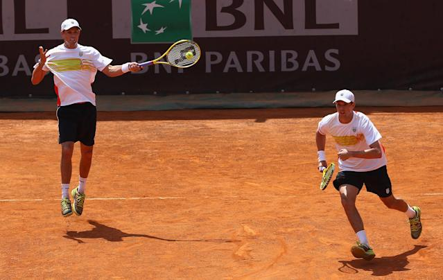 ROME, ITALY - MAY 16: Bob Bryan and Mike Bryan of the USA in action against Santiago Gonzalez of Mexico and Christopher Kas of Germany in their second round doubles match during day five of the Internazionali BNL d'Italia 2012 at the Foro Italico Tennis Centre on May 16, 2012 in Rome, Italy. (Photo by Clive Brunskill/Getty Images)