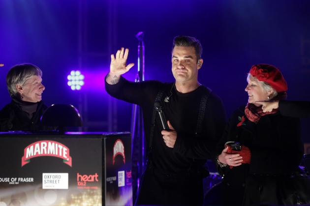 2012: Robbie Williams had the honour of turning on the famous Oxford Street lights. Copyright [WENN]