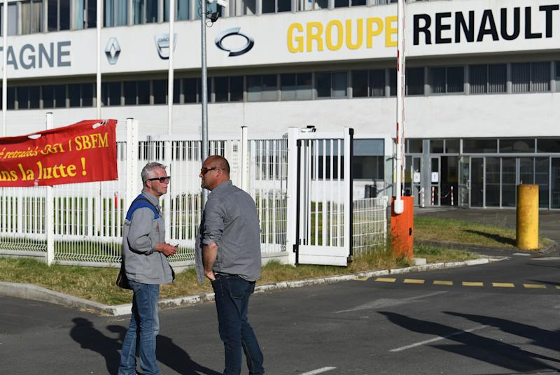 "Demonstrators stand in front of the entrance of the ""Fonderie de Bretagne"" foundry, a subsidiary of Groupe Renault, on May 28, 2020 in Caudan, western France. - French auto giant Renault plans to cut around 15,000 jobs worldwide, including 4,600 in France, as part of a two billion euro cost-cutting plan over three years, sources said on May 28, 2020. (Photo by Fred TANNEAU / AFP) (Photo by FRED TANNEAU/AFP via Getty Images)"