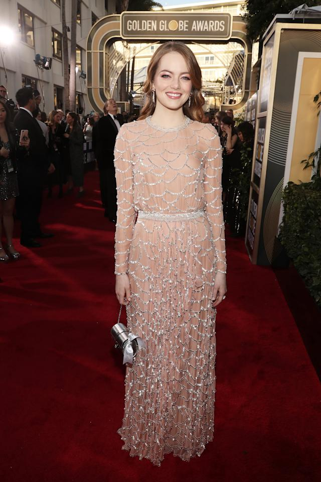 <p>Emma Stone went for a long-sleeved, pink, embellished gown at the Globes. Louis VuittonPhoto: Getty Images </p>