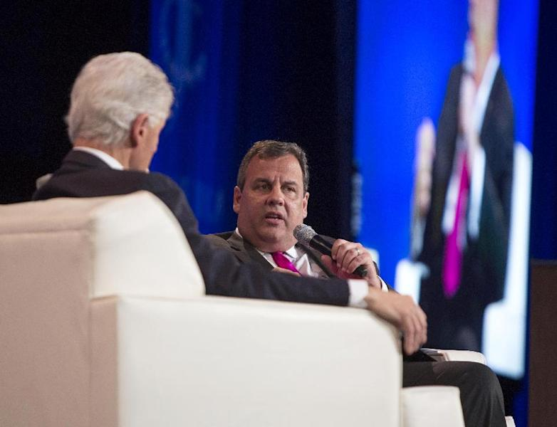 "New Jersey Gov. Chris Christie, right, speaks while former President Bill Clinton listens during the Clinton Global Initiative America's meeting, Friday, June 14, 2013, in Chicago. Clinton and Christie held a closing session titled ""Cooperation and Collaboration: A Conversation on Leadership."" (AP Photo/Scott Eisen)"