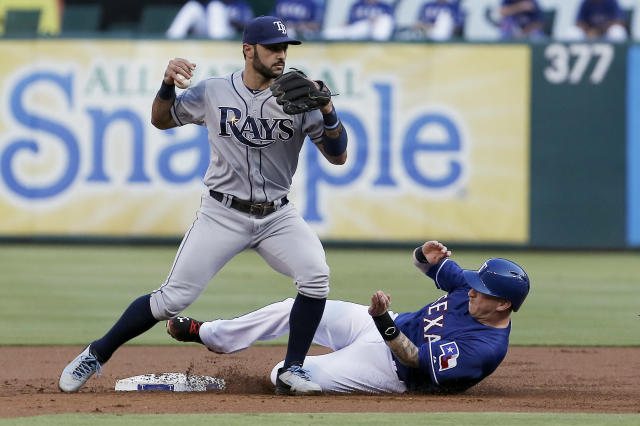 Tampa Bay Rays second baseman Sean Rodriguez (1) forces out Texas Rangers' Mike Carp (28) at second during the first inning of a baseball game, Wednesday, Aug. 13, 2014, in Arlington, Texas. Rodriguez was unable to make the throw to first for the double play. (AP Photo/Brandon Wade)