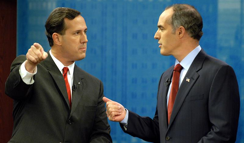 FILE - In this Oct. 12, 2006 file photo, then-Sen. Rick Santorum, R-Pa., left, and his opponent Democrat Bob Casey confront each other during the taping of a debate at the KDKA television studio in Pittsburgh. Republican presidential candidate Rick Santorum is as unpopular in Pennsylvania today as he was six years ago, when home-state voters kicked him out of the Senate in a rout. That sour public perception may doom his fading chances of sticking around in the GOP presidential race, along with other hurdles that dot his path to a possible, and needed, victory in the April 24 primary. (AP Photo/Steve Mellon, File)
