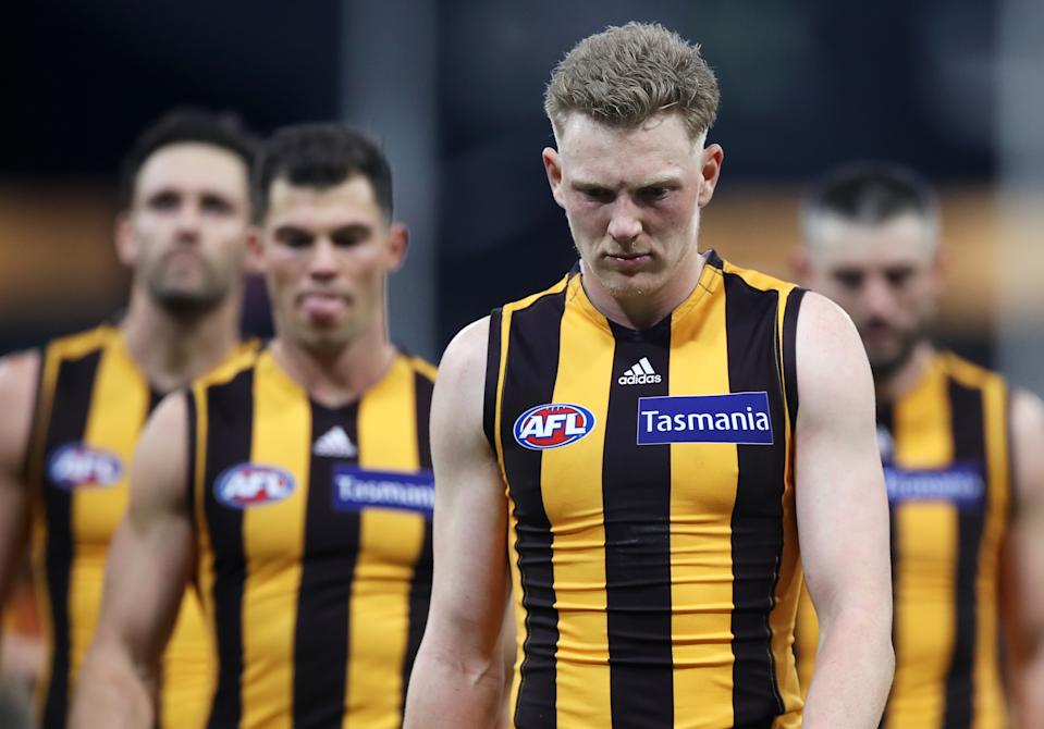 James Sicily and his team mates look dejected as they leave the field after defeat during the round 7 AFL match between the Hawthorn Hawks and the Melbourne Demons.