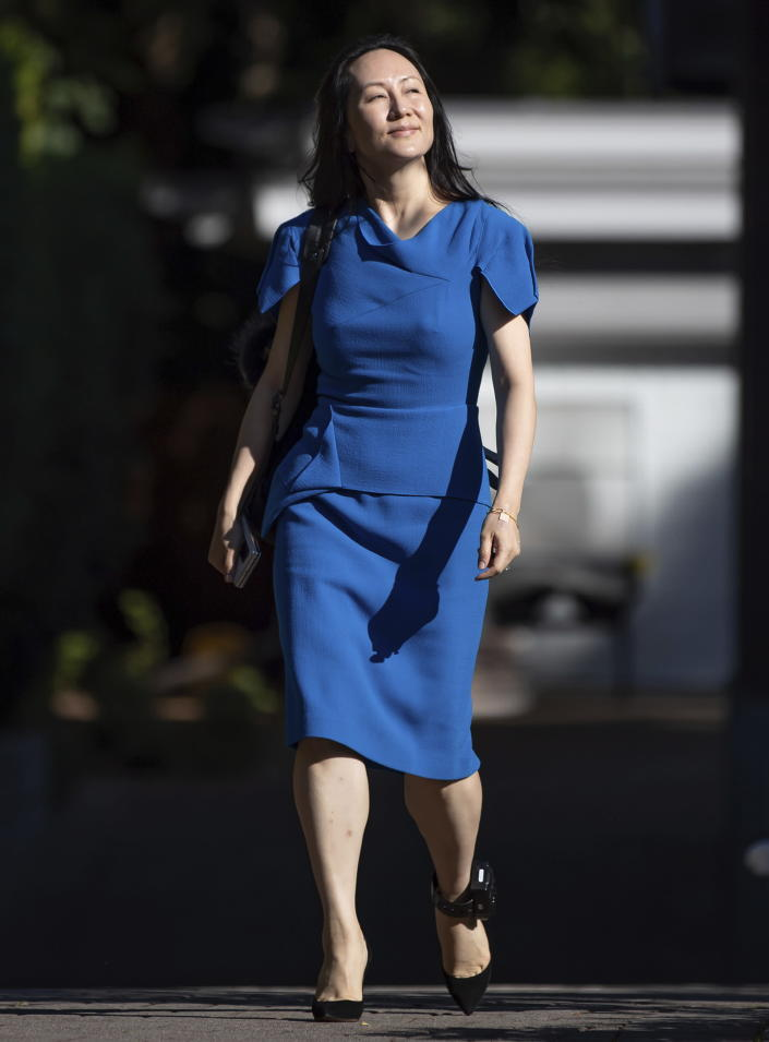 Meng Wanzhou, chief financial officer of Huawei, leaves home to attend her extradition hearing at B.C. Supreme Court, in Vancouver, British Columbia, Wednesday, Aug. 4, 2021. (Darryl Dyck/The Canadian Press via AP)