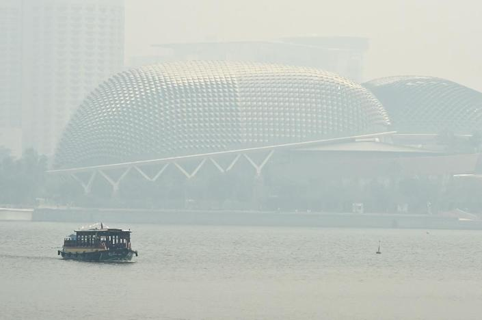Visibility from Singapore's high-rise offices and other vantage points on August 26, 2016, was virtually zero (AFP Photo/Roslan Rahman)