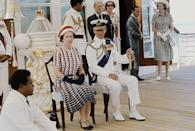 <p>Watching the entertainment aboard the Royal Yacht 'Britannia' in Fiji as part of a royal tour.</p>