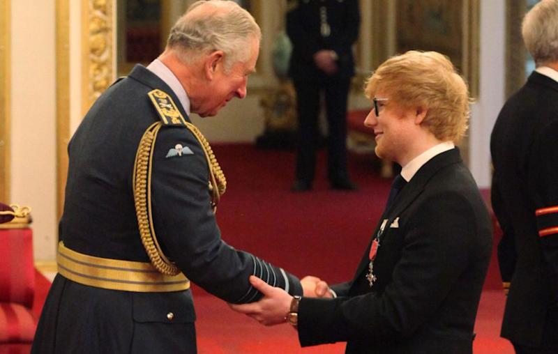 Ed Sheeran's royal faux pas when he met Prince Charles was touching his arm as he was handed over the MBE. Source: Getty