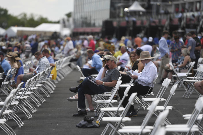 Spectators are seen in prior to an undercard race ahead of the Preakness Stakes horse race at Pimlico Race Course, Saturday, May 15, 2021, in Baltimore. (AP Photo/Will Newton)