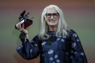 Jane Campion holds the Silver Lion Best Director award for 'The Power Of The Dog' onstage at the closing ceremony during the 78th edition of the Venice Film Festival in Venice, Italy, Saturday, Sept. 11, 2021. (AP Photo/Domenico Stinellis)