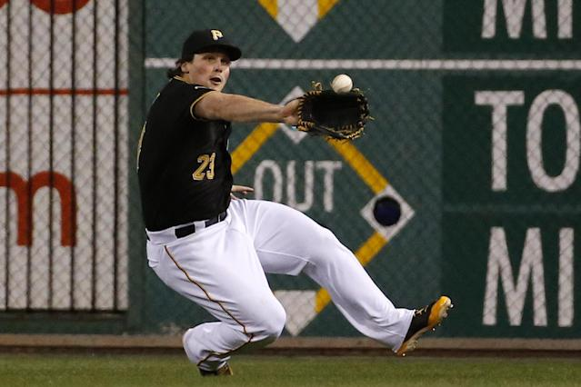 Pittsburgh Pirates right fielder Travis Snider slides to make the catch on a fly ball hit by Milwaukee Brewers' Jonathan Lucroy during the ninth inning of a baseball game in Pittsburgh, Thursday, April 17, 2014. The Pirates won 11-2. (AP Photo/Gene J. Puskar)