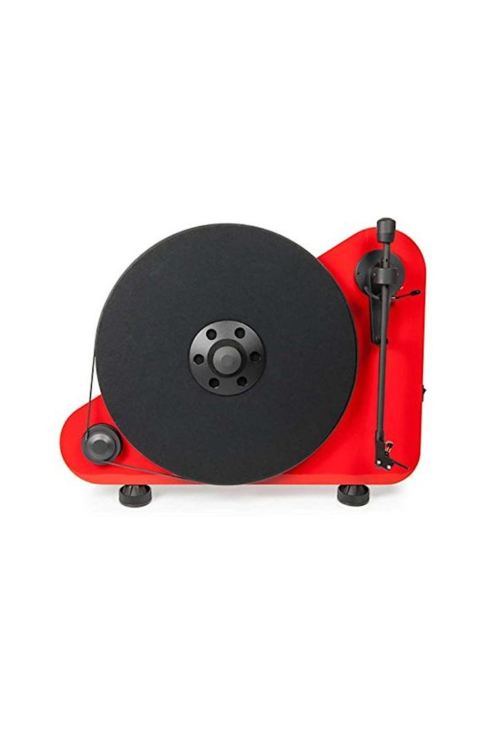 """<p><strong>Pro-Ject</strong></p><p>amazon.com</p><p><strong>$599.00</strong></p><p><a href=""""http://www.amazon.com/dp/B01LZ2N5X4/?tag=syn-yahoo-20&ascsubtag=%5Bartid%7C10067.g.13094996%5Bsrc%7Cyahoo-us"""" rel=""""nofollow noopener"""" target=""""_blank"""" data-ylk=""""slk:Shop Now"""" class=""""link rapid-noclick-resp"""">Shop Now</a></p><p>There's a <a href=""""https://www.cnbc.com/2017/04/13/vinyl-is-vintage-and-the-future-as-new-generation-warms-to-an-old-music-form.html"""" rel=""""nofollow noopener"""" target=""""_blank"""" data-ylk=""""slk:vinyl revival"""" class=""""link rapid-noclick-resp"""">vinyl revival</a> going on, and an eye-catching turntable like this one will help you be a part of it. It has built-in Bluetooth, so it can connect to audio systems wirelessly.</p>"""