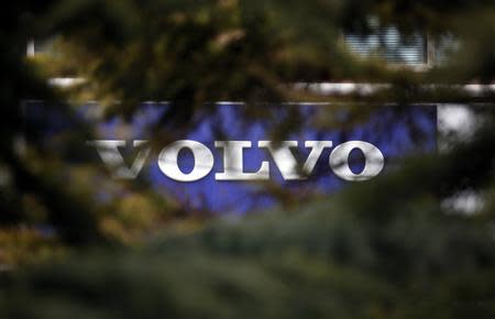 Volvo logo is seen through trees at a dealer's shop in Beijing