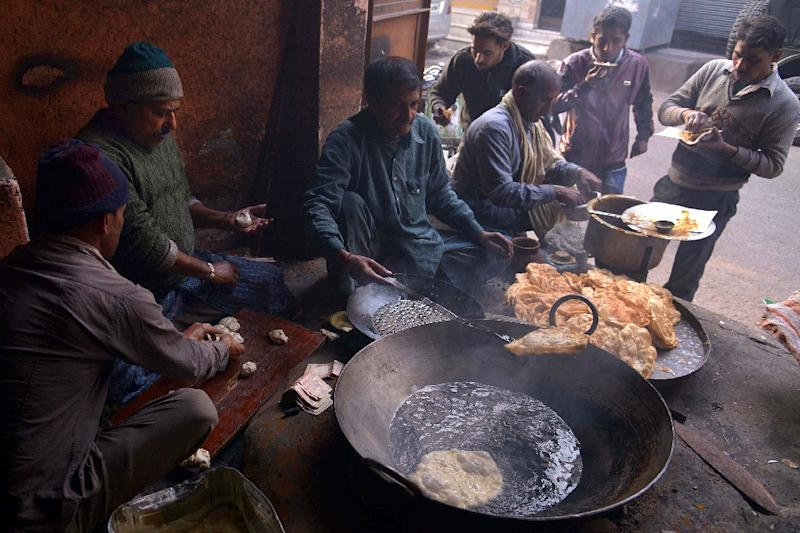 If greenhouse gas emissions continue at current rates, this would cut projected increases in food availability by about a third before mid-century, the study found (AFP Photo/Narinder Nanu)