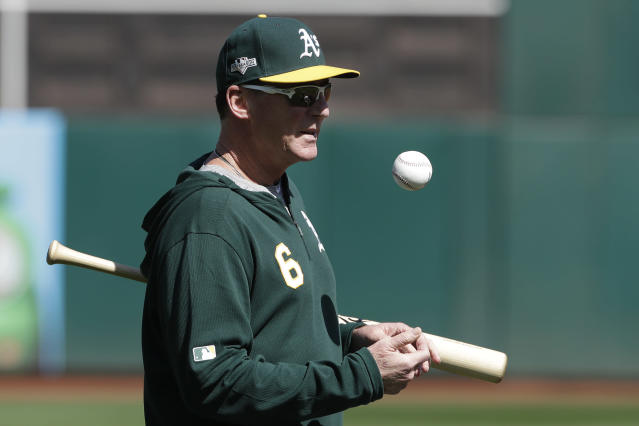 Oakland Athletics manager Bob Melvin watches baseball practice in Oakland, Calif., Tuesday, Oct. 1, 2019. The Athletics are scheduled to face the Tampa Bay Rays in an American League wild-card game Wednesday, Oct. 2. (AP Photo/Jeff Chiu)