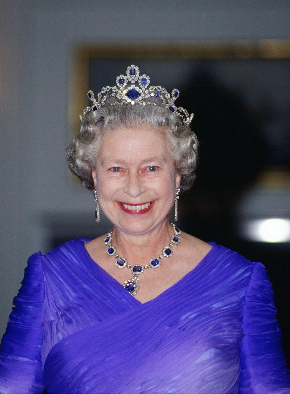 <p>The Queen's diamond and sapphire necklace and earrings, known fittingly as the Victorian Suite of Sapphire and Diamond set, were made originally in 1850 and gifted to Lilibet by her father, King George VI, for her wedding. The matching tiara was made in 1963. She's seen wearing them here on June 11, 1992.</p>