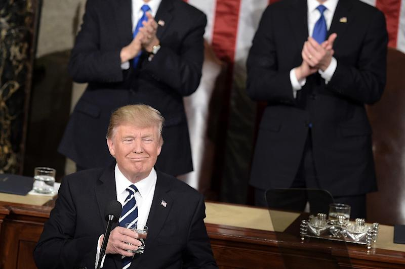 US President Donald Trump pauses for applause while speaking during a joint session of Congress on Capitol Hill February 28, 2017 in Washington, DC