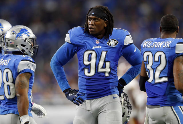 FILE - In this Oct. 23, 2016, file photo, Detroit Lions defensive end Ezekiel Ansah stands in the sideline during the first half of an NFL football game against the Washington Redskins in Detroit. Ansah has signed his franchise tag, signaling his return to the Detroit Lions, the team announced Tuesday, April 17, 2018. Detroit designated the defensive end from Ghana as its franchise player nearly two months ago. (AP Photo/Paul Sancya, File)
