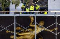 The 2020 Rockefeller Center Christmas tree, a 75-foot tall Norway Spruce that was acquired in Oneonta, N.Y., is secured on a platform at Rockefeller Center Saturday, Nov. 14, 2020, in New York. (AP Photo/Craig Ruttle)
