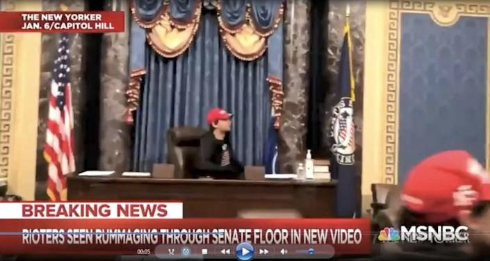 Christian Secor, was captured on video camera inside the Senate chambers sitting at the Presiding Officer's chair, after the pro-Trump mob broke into the Capitol.