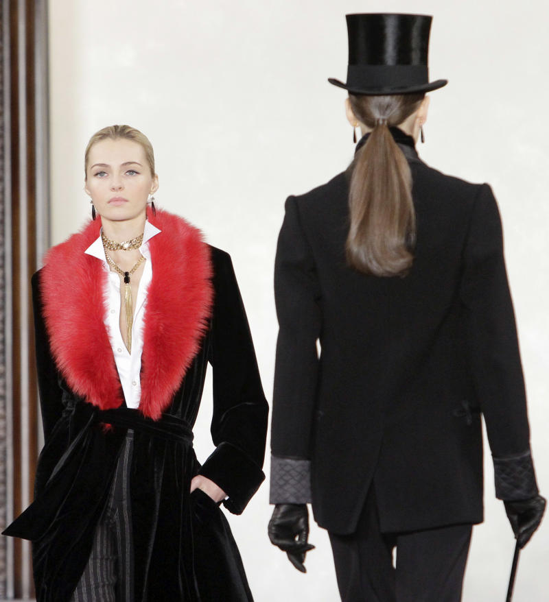 """FILE - This Feb. 16, 2012 file photo shows fashion from the Fall 2012 collection of Ralph Lauren in New York. The preview of Ralph Lauren's fall collection, held earlier this year, paid homage to """"Downton Abbey"""", with models walking down the runway to the music of the show. Lauren had he was inspired by """"the heritage and romance of England."""" (AP Photo/Bebeto Matthews, file)"""