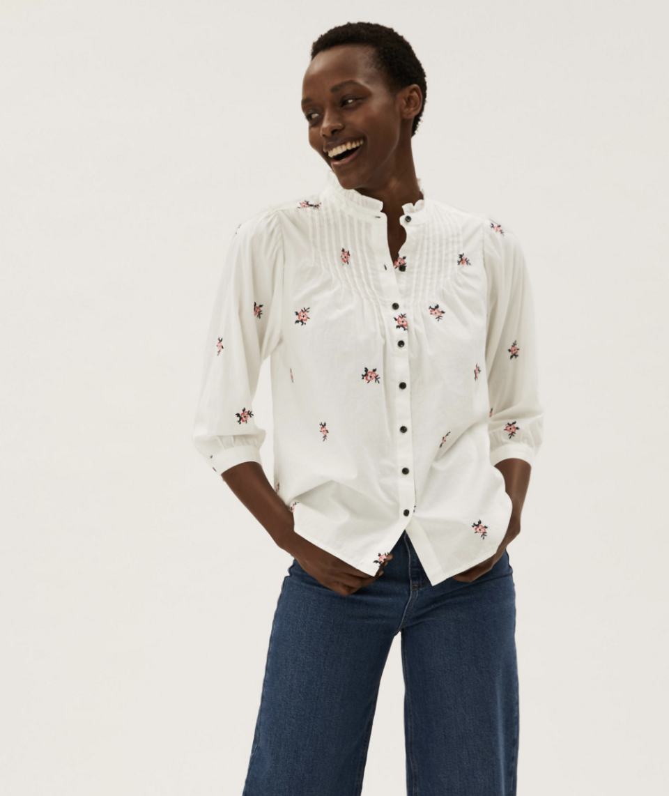 Holly's cotton blouse comes in a white floral design, as well as vibrant blue. (Marks and Spencer)