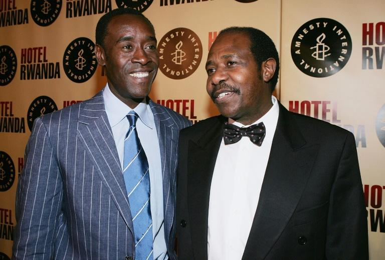 Paul Rusesabagina is pictured with American actor Don Cheadle who played him in the Hollywood film 'Hotel Rwanda' (AFP/CARLO ALLEGRI)