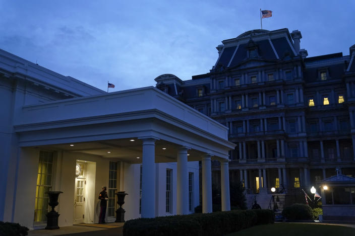 FILE - In this Nov. 25, 2020, file photo a Marine stands outside the entrance to the West Wing of the White House, signifying that President Donald Trump is in the Oval Office in Washington. (AP Photo/Patrick Semansky, File)