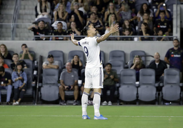 Los Angeles Galaxy's Zlatan Ibrahimovic (9) celebrates after scoring against Los Angeles FC during the first half of an MLS soccer match Sunday, Aug. 25, 2019, in Los Angeles. (AP Photo/Marcio Jose Sanchez)