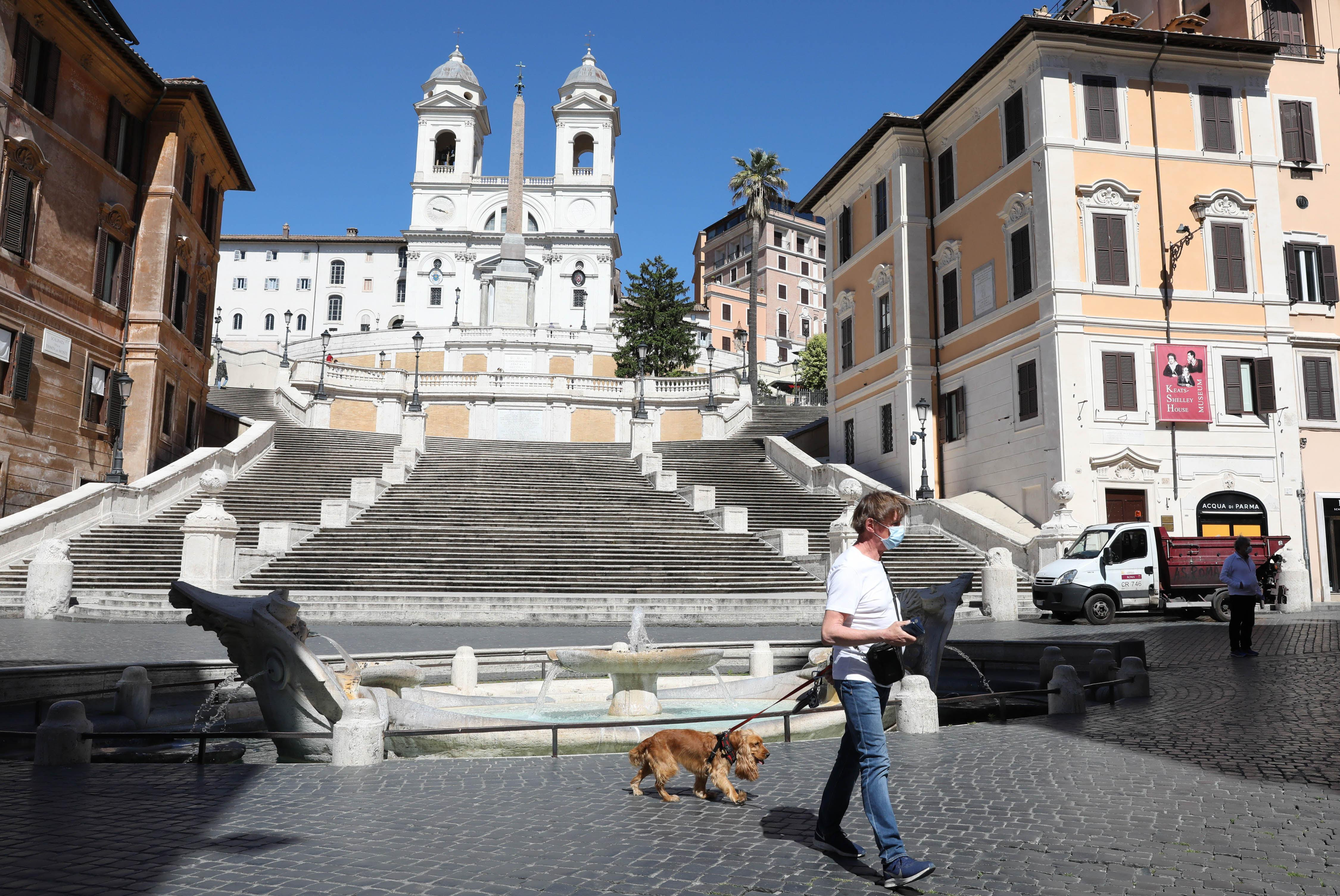 ROME, May 4, 2020 .A man walks his dog at the Piazza di Spagna in Rome, Italy, May 4, 2020. The coronavirus pandemic has claimed over 29,000 lives in Italy, bringing the total number of infections, fatalities and recoveries to 211,938 as of Monday, according to the latest data released by the country's Civil Protection Department. Italians enjoyed more liberties on Monday, as some restrictions on productive activities and personal movements were relaxed for the first time after almost eight weeks. (Photo by Cheng Tingting/Xinhua via Getty) (Xinhua/Cheng Tingting via Getty Images)