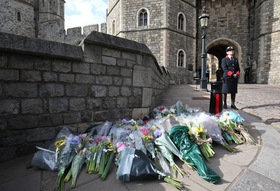 Flowers left outside Windsor Castle, Berkshire, following the announcement of the death of the Duke of Edinburgh at the age of 99. Picture date: Friday April 9, 2021. (Photo by Jonathan Brady/PA Images via Getty Images)