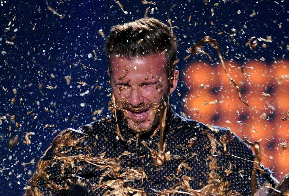 <p>Cannot believe everyone else had to deal with the most disgusting slime color <em>ever</em> and David Beckham was out here being sprayed with liquid gold.</p>